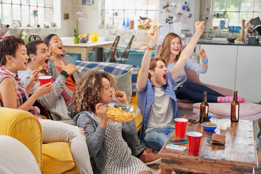 people enjoying a football game on tv